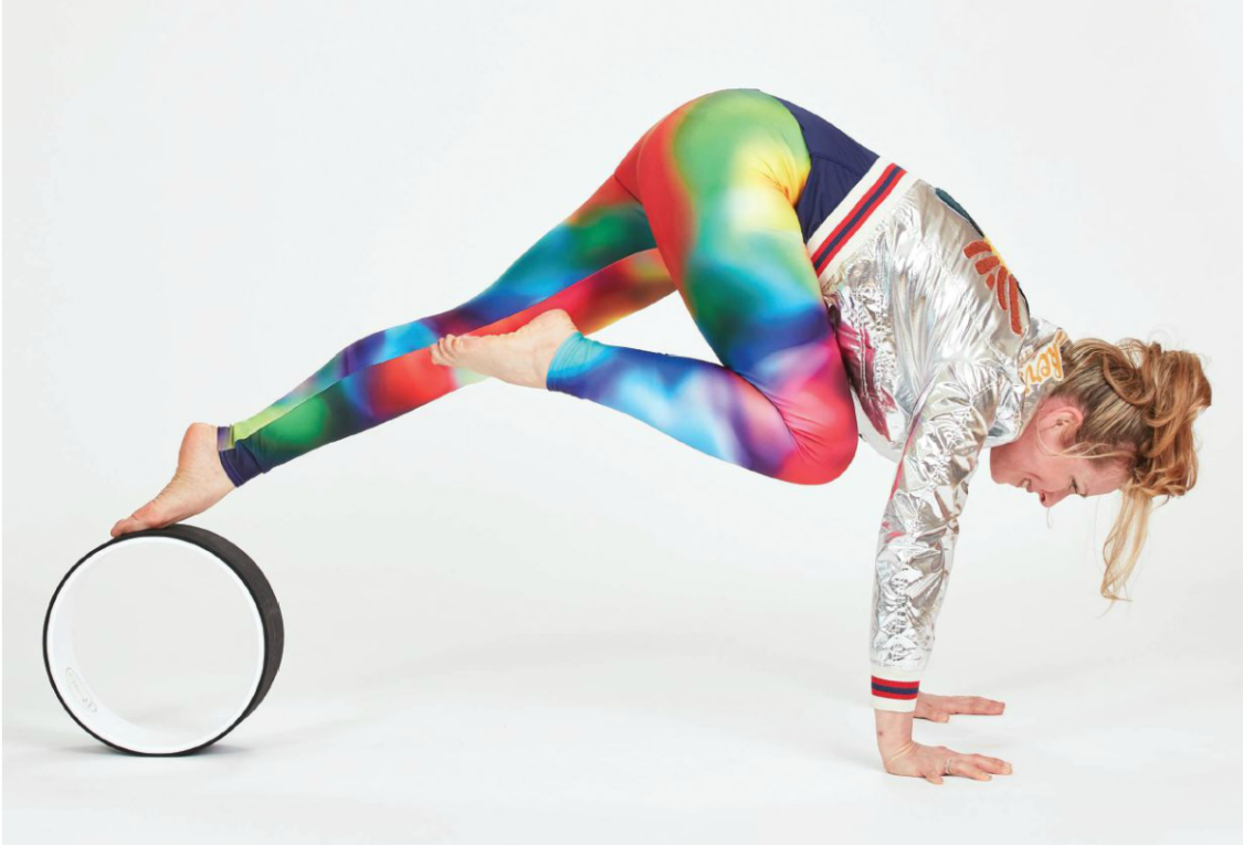 Seven Therapeutic Benefits Of Using A Yoga Wheel