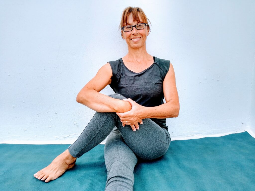 yoga for athletes trainer Sarah Ramsden demo Outside of hip stetch